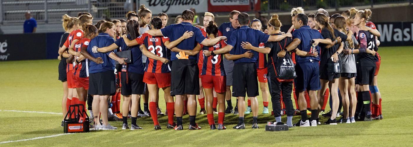 Football teams in huddle image